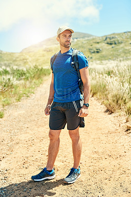 Buy stock photo Shot of a young man out on a hike