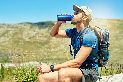 Buy stock photo Cropped shot of a young man taking a break while out on a hike