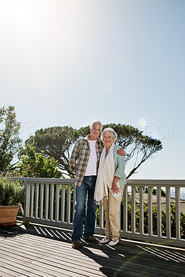 Buy stock photo Shot of a happy senior couple relaxing together on the patio at home