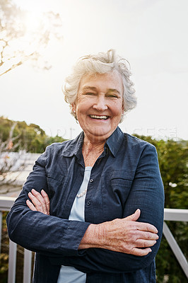 Buy stock photo Portrait of a happy and confident senior woman standing outside