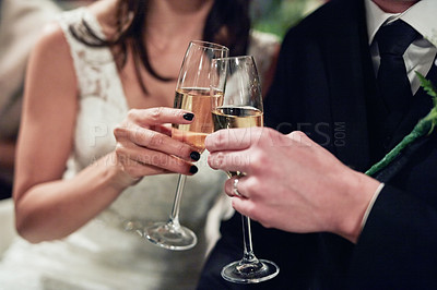 Buy stock photo Cropped shot of a newlywed couple toasting with wine on their wedding day