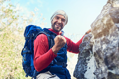 Buy stock photo Portrait of a happy young hiker enjoying a mountain trail on his own
