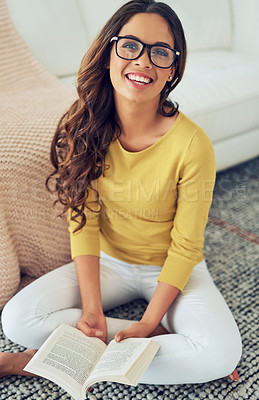 Buy stock photo Shot of a beautiful young woman relaxing at home