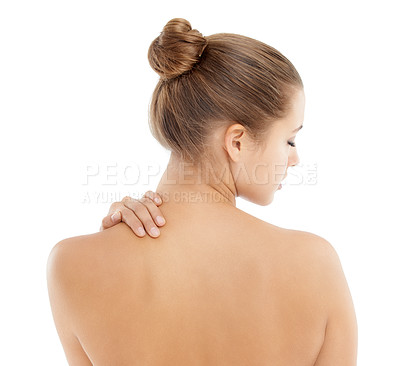 Buy stock photo Rearview of a young topless woman touching her back