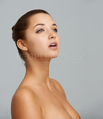 Buy stock photo A gorgeous young woman against a gray background