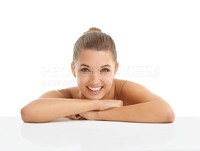 Buy stock photo Portrait of beautiful young woman giving you a smile isolated on white