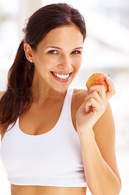 Buy stock photo Portrait of sweet young brunette holding a fresh ripe apple