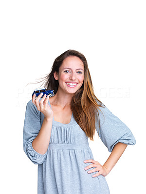 Buy stock photo Portrait of a happy young female holding a cute car in hand against white background