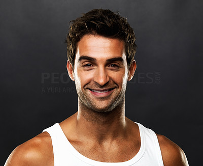 Buy stock photo Closeup portrait of young guy smiling on black background