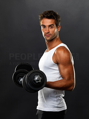 Buy stock photo Portrait of man lifting dumbbells on black background