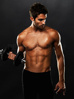 Buy stock photo Fit muscular man exercising with a dumbbell on black background