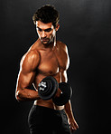 Young muscular man lifting weights