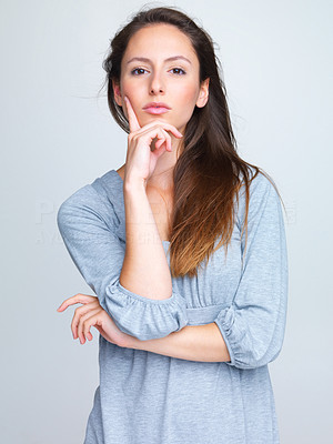 Buy stock photo Portrait of a lovely young female model posing against grey background