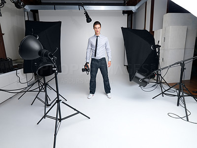 Buy stock photo Portrait of a successful young male fashion photographer standing in his studio