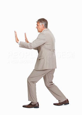 Buy stock photo Studio shot of a mature businessman stopping something against a white background