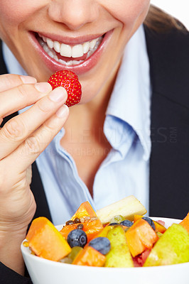 Buy stock photo Closeup of business woman eating strawberry on white background