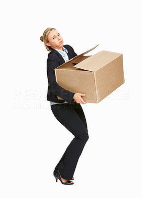 Buy stock photo Full length of mature business woman carrying heavy carton over white background
