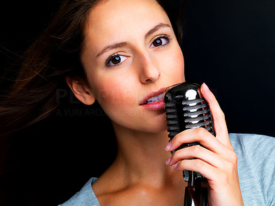 Buy stock photo Closeup portrait of a cute young female star performer holding old fashioned microphone
