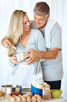 Buy stock photo Portrait of loving mature couple preparing batter in kitchen at home