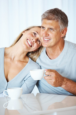 Buy stock photo Portrait of happy mature man holding cup of tea with his wife indoors