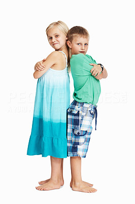Buy stock photo Full length of mischievous young boy and girl standing back to back over white background