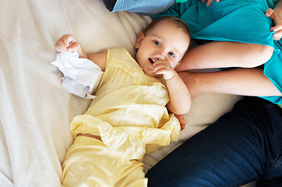 Buy stock photo Portrait of an adorable toddler laid on the bed looking at you