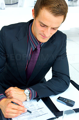 Buy stock photo Businessman at an airport restaurant doing working