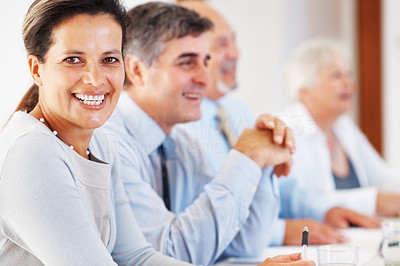 Buy stock photo Closeup of happy business woman with colleagues in row during meeting