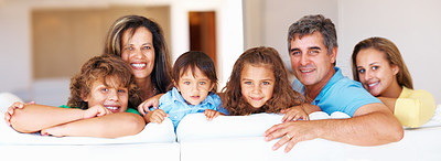 Buy stock photo Family portrait of mature couple with their kids smiling
