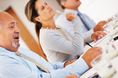 Buy stock photo Business colleagues sitting in row during business presentation and paying attention