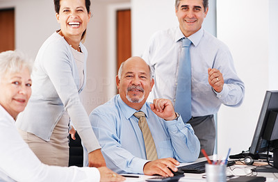Buy stock photo Portrait of successful business people smiling at office desk