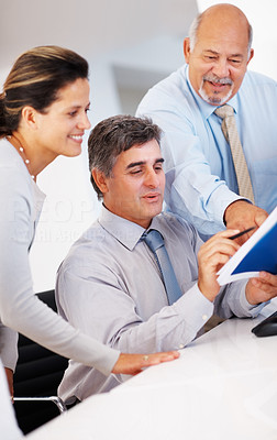 Buy stock photo Three business people discussing during corporate meeting