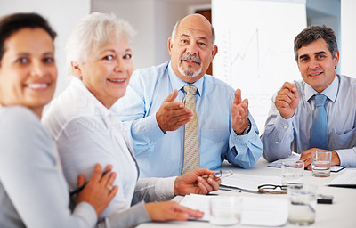 Buy stock photo Mature business man discussing with his team during meeting