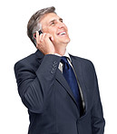 Smiling mature businessman calling on mobile phone