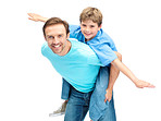 Piggybacking - Happy young guy playing with his son on white