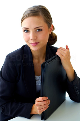 Buy stock photo Portrait of a smiling young businesswoman holding a file