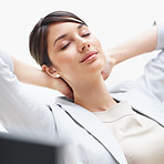 Young female business executive relaxing at her desk