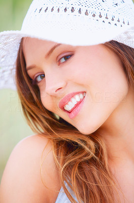 Buy stock photo Portrait of an attractive young woman sitting outdoors