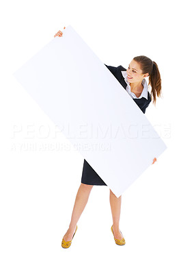 Buy stock photo Portrait of a beautiful businesswoman holding a blank billboard tilted, and looking at it. This isolate was taken in our studio.