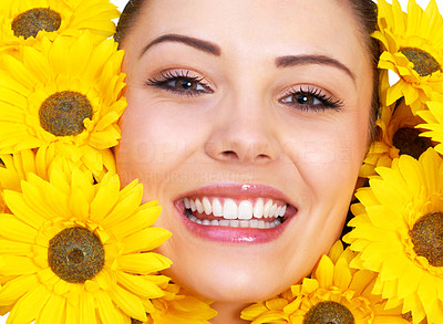 Buy stock photo Portrait of a smiling young woman surrounded by yellow flowers
