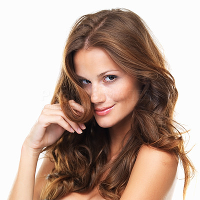 Buy stock photo Portrait of a beautiful woman smiling at you while holding a strand of her hair to her face, isolated on white