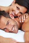Sexy couple smiling in bed