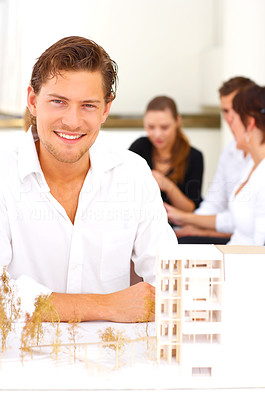 Buy stock photo Cropped shot of a group of architects sitting in the boardroom