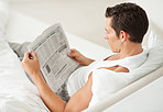 Reading the morning newspaper