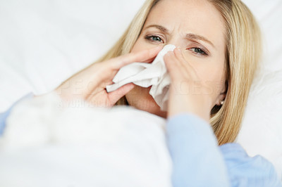 Closeup of a young woman having cold