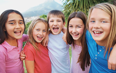 Excited group of little kids standing together outdoors