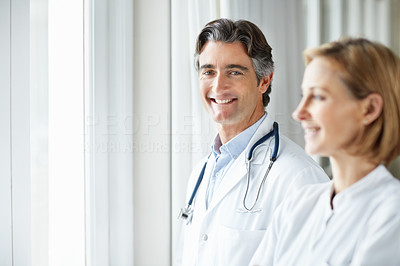 Medical colleagues - Handsome doctor smiling in the background