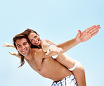 Cheerful young couple having fun together on holiday