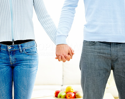 A happy couple holding each other\' hand