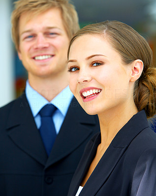 Buy stock photo Portrait of two young businesspeople standing in the office